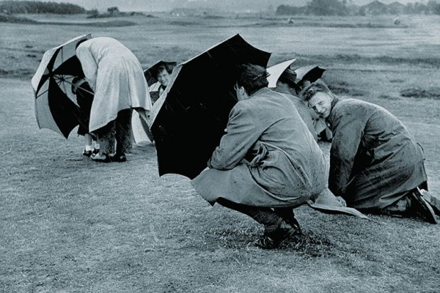 Sheltering under umbrellas