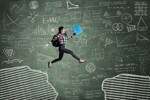 Student in front of blackboard