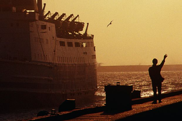 Silhouette of person waving to departing ferry, Boulogne-sur-Mer, France