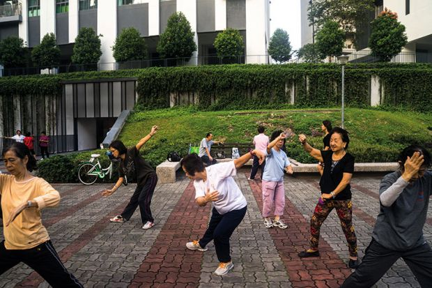 People practise tai chi in Singapore