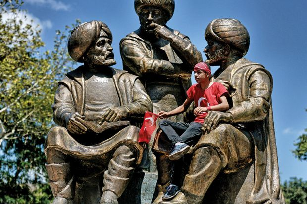 Sitting on a statue in Turkey