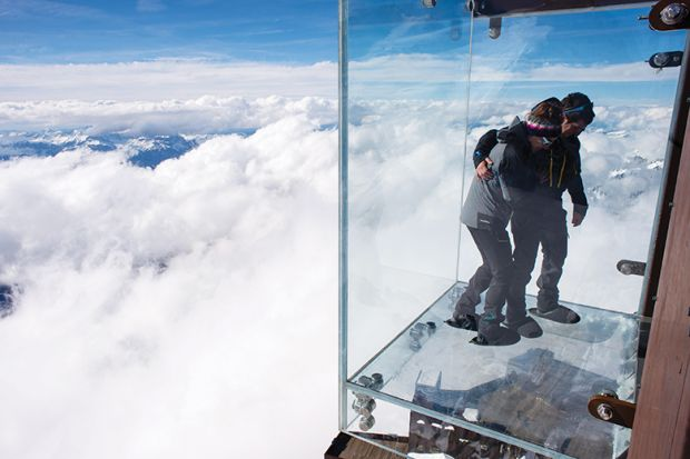 People standing on a glass viewing platform