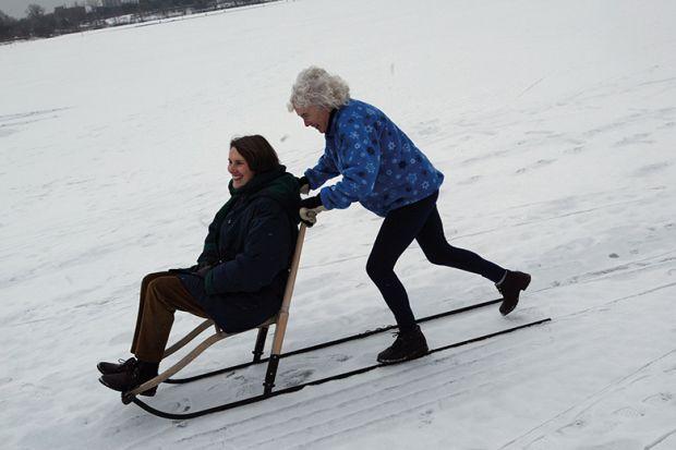 Two women on sledge
