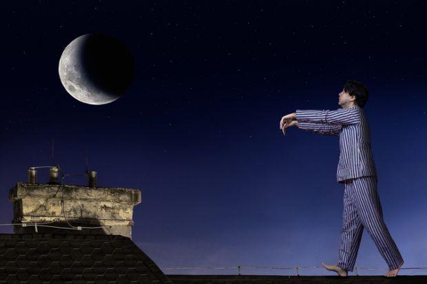A man sleepwalking on a roof