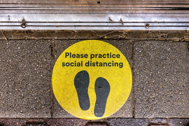 a social distancing sign