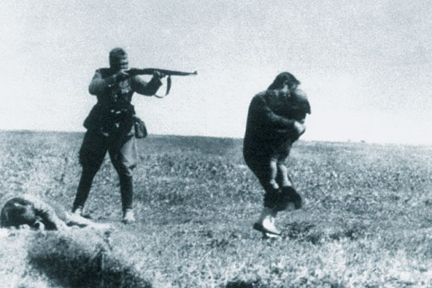 Soldier firing gun at woman and child, World War Two
