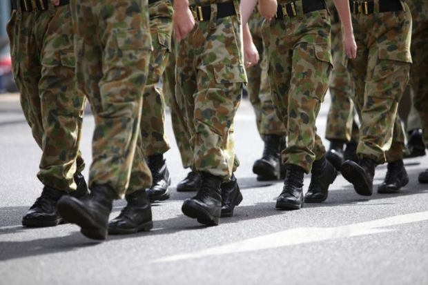 Soldiers in camouflage fatigues marching