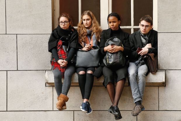 Sorbonne University students sitting on window ledge
