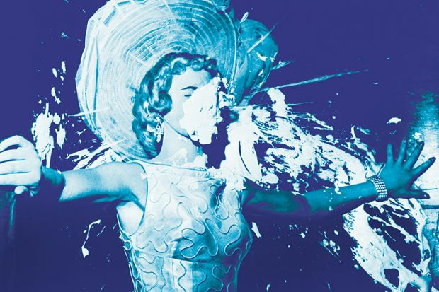 Elegant woman hit with a cream pie illustrating public rudeness in academia
