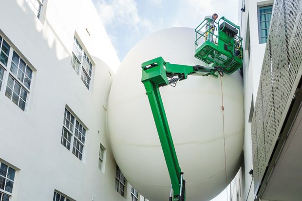 Giant balloon wedged between two buildings