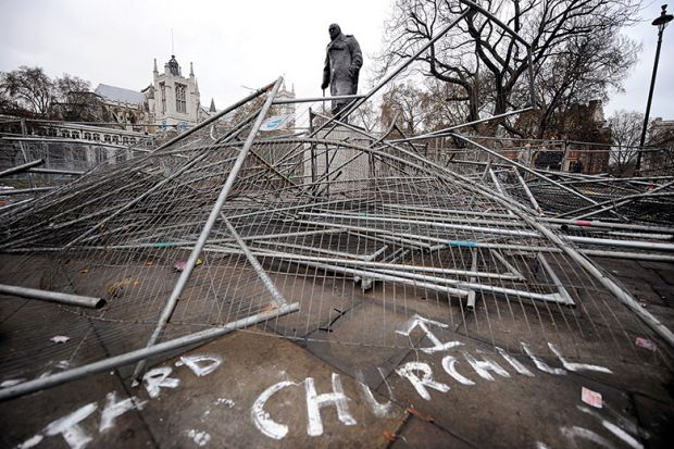 Statue of Winston Churchill, broken security barriers, Parliament Square, London