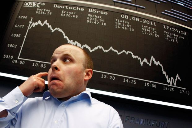 Trader reacts to DAX index board, Frankfurt stock exchange