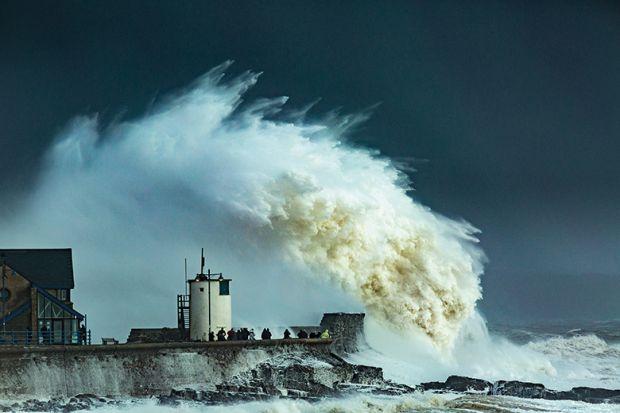 Huge wave crashes on pier