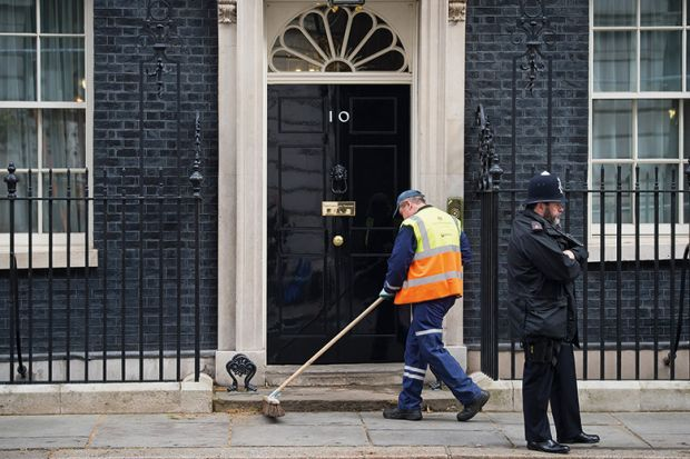 Street cleaner outside Downing Street