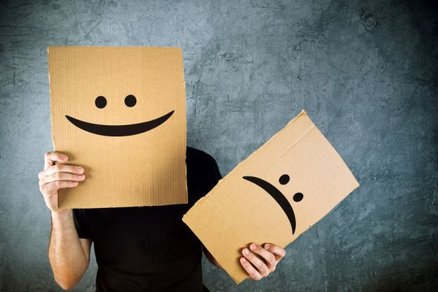 Happy and sad cardboard faces