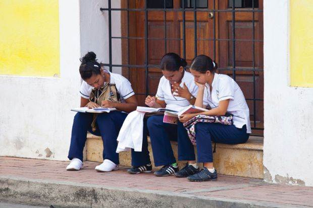 Students at work, Getsamani old town, Cartagena, Colombia