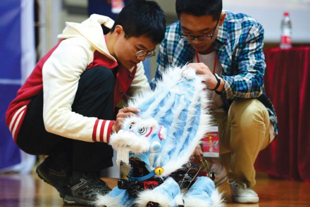 Students demonstrate lion dance robot, RoboGame competition, China