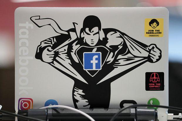Superman sticker on Macbook computer