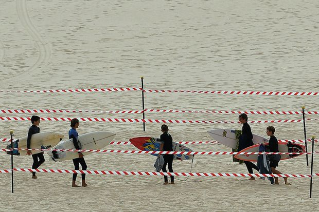 Surfers carry their boards on Sydney's Bondi Beach after it reopened after a five week closure, autonomy, free from meddling