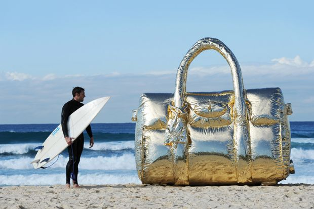 Surfer with a giant handbag