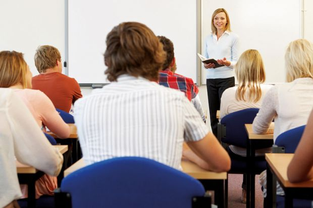 Teacher speaking at front of classroom