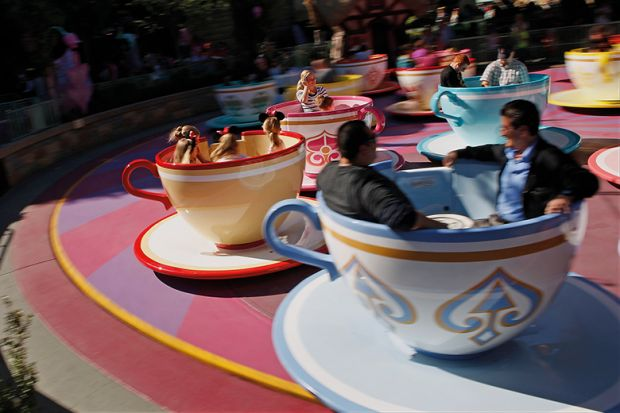 Guests ride the Tea Cups at Walt Disney Co.'s Disneyland Park in Anaheim, California