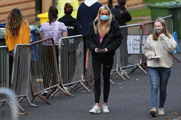 Students walk at a pop-up testing centre for Covid-19 in Glasgow, Scotland on September 24, 2020