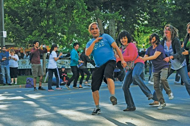 Members of the public perform the Conga dance