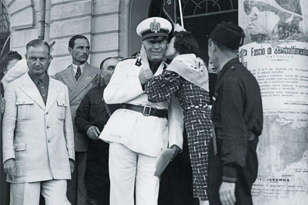 Mussolini being kissed