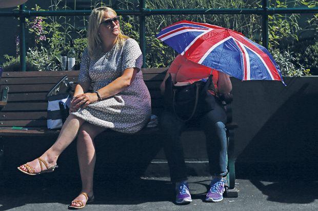 Person with Union Jack umbrella