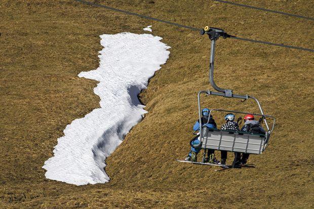 ski lift in a snowless landscape