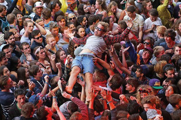 fans crowd surf
