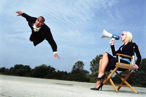 Businesswoman with megaphone shouting at man flying, outdoors
