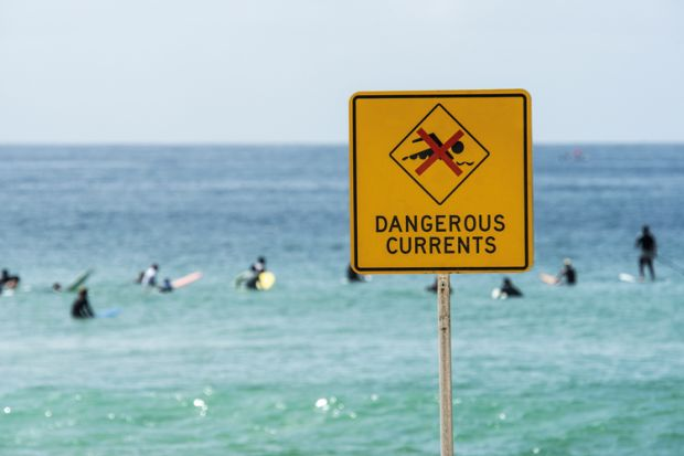 Dangerous currents warning sign on beach, Australia