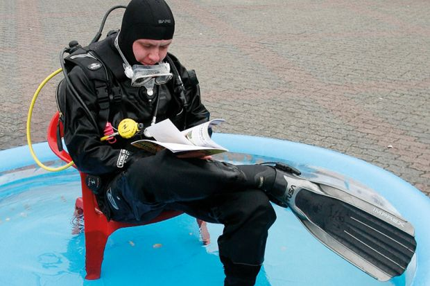 Scuba diver in a paddling pool