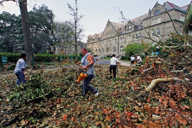 Workers remove debris at Tulane University after Hurricane Katrina