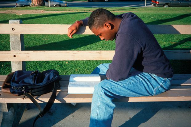 Black student on bench