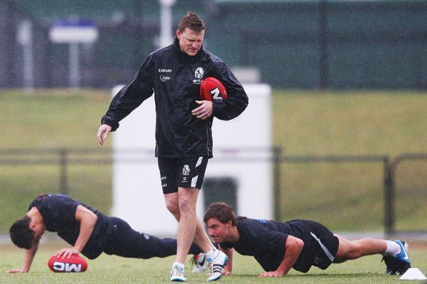 Rugby players doing press-ups