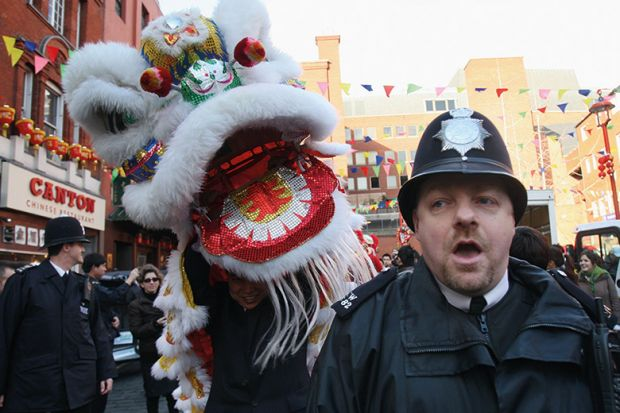 British policeman with Chinese dragon