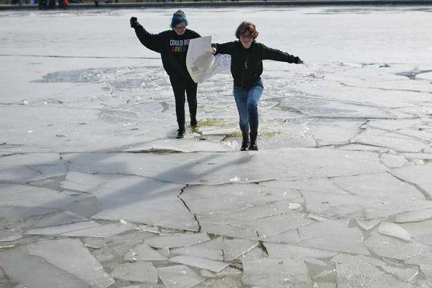 Protestors run over breaking ice