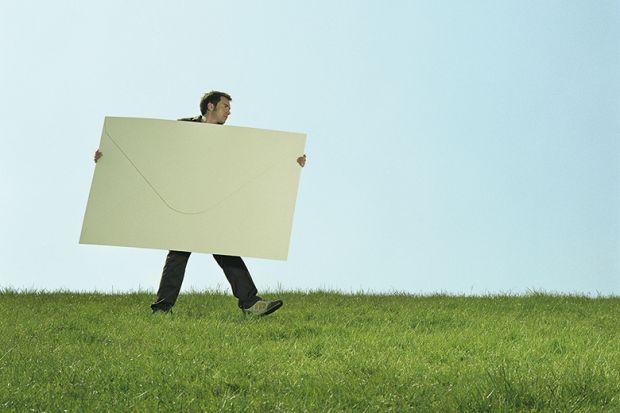Man carrying giant envelope
