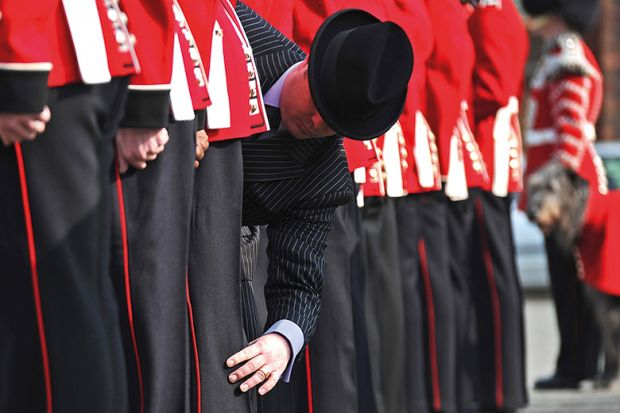 Master Taylor checks the cut of an Irish Guard's uniform
