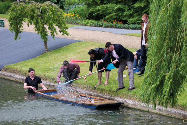 Cambridge University students on the River Cam. Punt is sinking