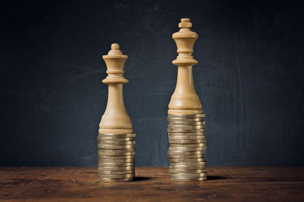 King and Queen chess pieces on pile of coins