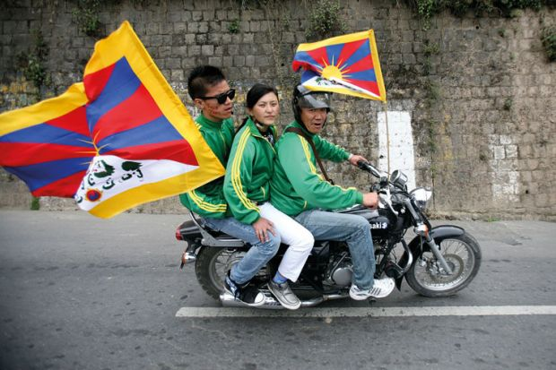 Exiled Tibetan protesters riding on motorbike