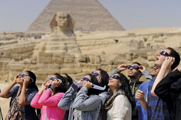People viewing solar eclipse, Pyramids of Giza, Sphinx, Egypt