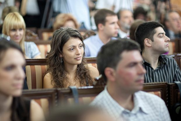 A student sitting in a lecture theatre