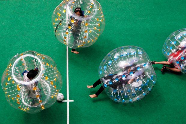 Participants enjoying bubble soccer