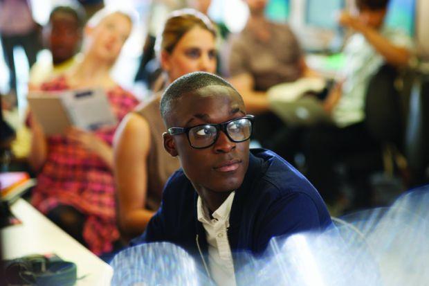 Male university student listening to seminar