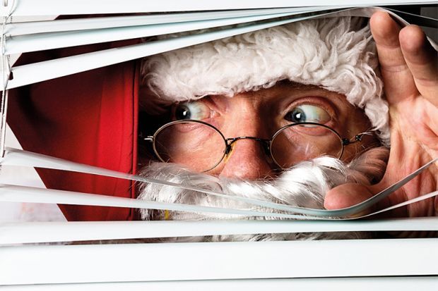 Santa peeping through blinds